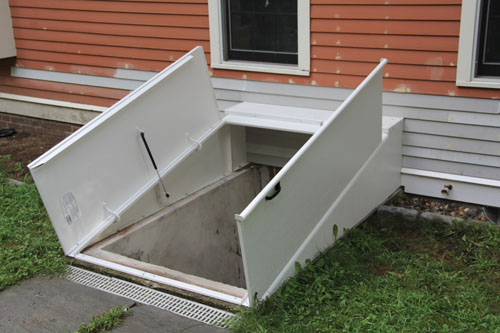 Install a basement bulkhead door extreme how to for Basement outside entrance cost