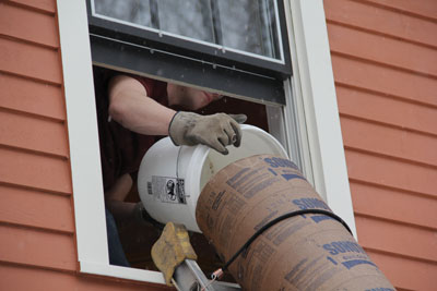Second-story remodels can utilize a garbage chute at the bathroom window.