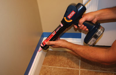 Masking the joint with painter's tape can create a crisp caulk line with minimal mess.