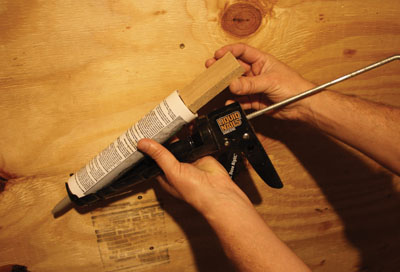 Squeeze out the last bit of caulk from your tube by using a wood block or dowel as a plunger extension.