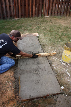 Screed the concrete even the form.