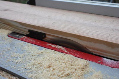 I ripped rabbets along the inside edges of the 2x8's to conceal the ends of the T&G boards.