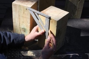"The notches in the bed posts were marked with a speed Square, allowing 3-1/2"" of each 2x4 to set inside the post."