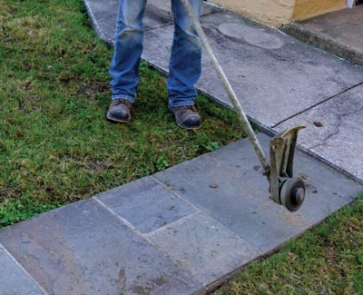 Pro landscapers often flip the head of a string trimmer vertically for use as a lawn edger.
