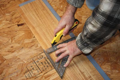 Vinyl planks can easily be cut with a Speed Square and utility knife.