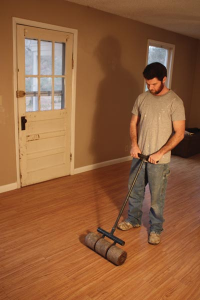 Once the floor is complete, roll the entire installation with a floor roller.