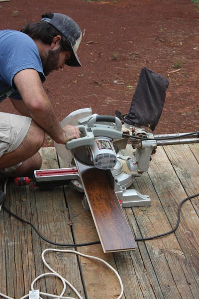 Laminate is easy to cut with a handheld circ saw, miter saw or even a hand saw. However, a table saw is the best tool for ripping boards to width.