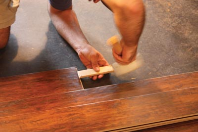 A mallet and wood block can be used to lock the end joints together.