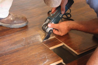 An oscillating multi-tool is a handy gadget for notching out floor registers and under-cutting door jambs.