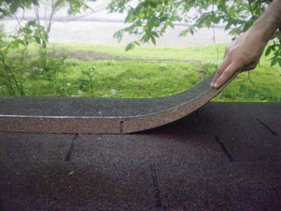 Whether you're applying a first layer of shingles or a second, asphalt roofing always begins with a starter strip.