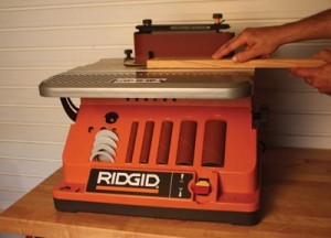 The Ridgid EB4424 works as an oscillating belt sander and features on-tool accessory storage.
