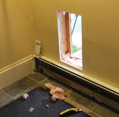 This photo shows the baseboard radiator that we had to work around.