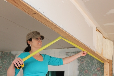 "Even though pocket door hardware is adjustable after the doors are hung, if you're framing the walls yourself, it's best to layout the rough opening carefully and make sure the head jamb is as level as possible. If the floor isn't level, as is often the case in old houses or in basement remodels, lay out from the high spot and make sure to keep at least 3/4"" clearance under the door when it's installed."