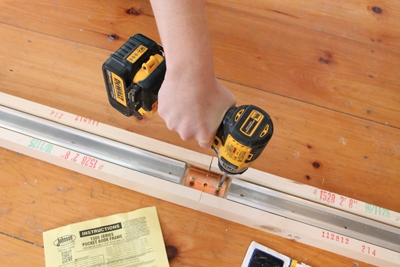 Installing a pocket door is one of those projects where you need your DIY mojo of knowing how to solve problems. But you also need to read the instructions for the hardware you're installing. We used a kit from Johnson Hardware.