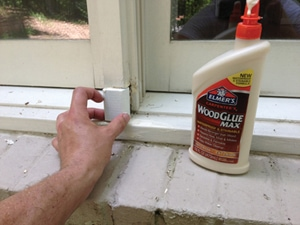 Glue and/or nail the replacement carefully into the void. Use an exterior-grade wood glue or construction adhesive.