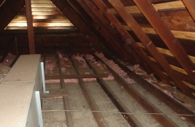 Insulation should be installed in the bare attic joist bays with the paper facing toward the living space.