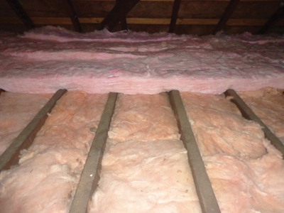 When installed perpendicular to the faced fiberglass insulation, the additional layer of unfaced rolled insulation provides extra R value while also insulating the wood framing members, which don't otherwise provide a very effective thermal break.