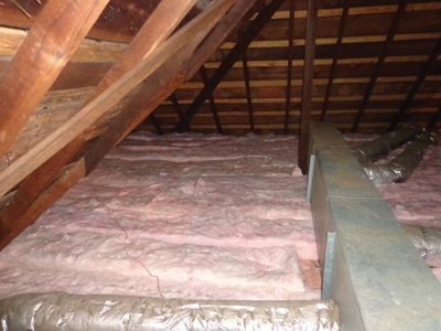 Here's the completed attic with the new fiberglass insulation completely installed for a combined R-value of 49.