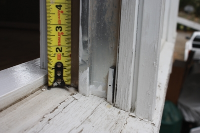 Measure the height of windows from the sill to the top jamb. The sill is usually sloped to shed water away from the house, so it's important to take the measurement from the uppermost point of the sill.