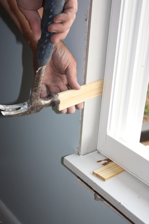 Leaving a little space around the window allows room for shims and insulation.