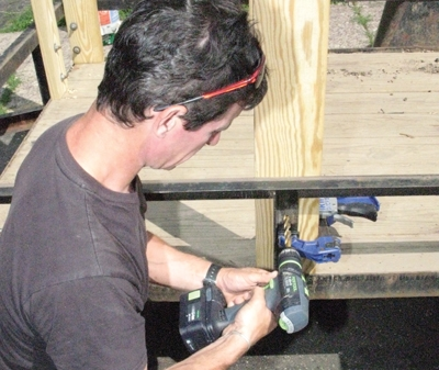 Clamp the stave square to the trailer frame and drill the hole for the through-bolt.