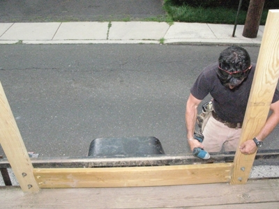 I span the trailer's wheel well with blocking on the inside of the trailer, installing the boards flush with the staves.