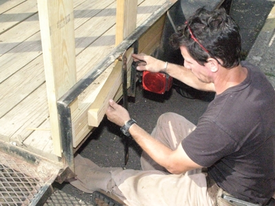 Add blocking as needed to create a wall around the trailer's angle iron projections.