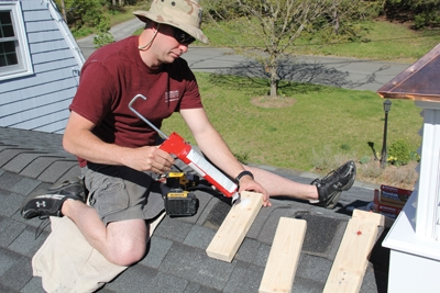 Predrill holes in the 2x4 mounting blocks and apply silicone to the bottom of the prior to attaching them to your roofing.
