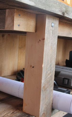 Note that the legs are notched to carry the weight of the support frames of the shelf