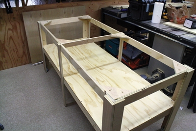 Here's an example of a custom-built assembly table (no top yet).