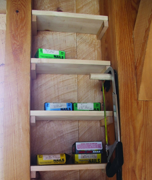 Shelves don't have to be fancy. Simple wooden platforms can store items off the floor and easily visible.