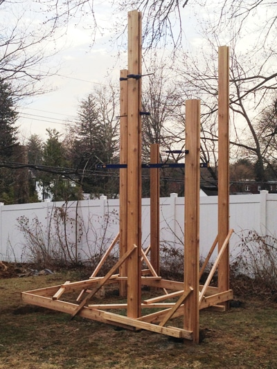 For the second-level posts (shorter posts, foreground) we used outriggers from the template to mark them for layout then stabilize them for installation.