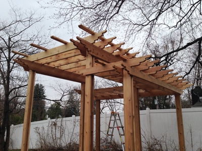 Here's the pergola with all its pieces from the ground up. The combination of posts, girders, rafters and purlins can be modified for almost limitless design choices.