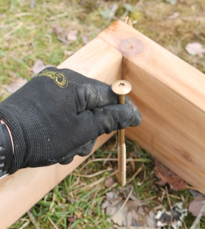 Use screws stuck through a piece of tape to mark the centers of the post holes.