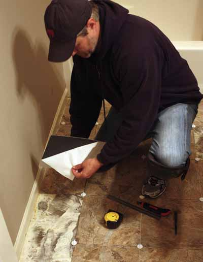 The tiles install easily by simply peeling off the paper backing and pressing the adhesive side firmly to the subfloor.