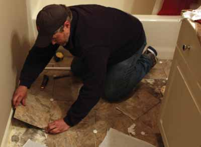 Tiles along the walls will often have to be cut to fit.