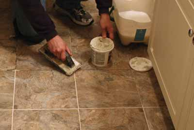 Apply the grout with a rubber float.