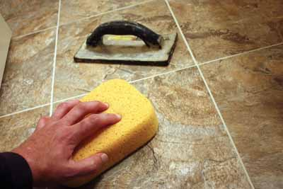 Use a sponge and plenty of clean water to clean up excess grout as your work.