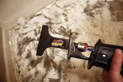 A spyder scraper attachment for a reciprocating saw speeds up the job dramatically.