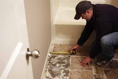 """Lay out a dry run to determine tile placement. Avoid """"silver"""" tiles against the walls and watch out for repeating patterns."""