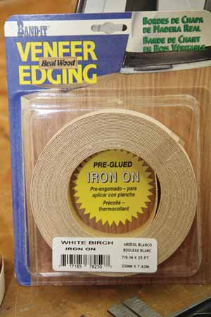 Veneer tape, also called edge banding, is available at woodworking stores and comes with heat-activated adhesive backing.