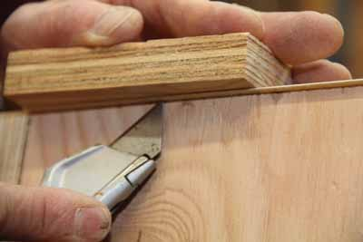 Use a table surface or a wood block as solid backing when trimming the tape.