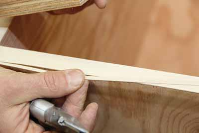 A sharp utility knife will make a clean cut through the tape.