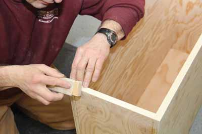 Slightly angle your sanding block to round the corners.