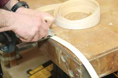 Cut off a slightly longer piece of tape than you need.