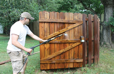 First step is to pressure-wash the fence to rejuvenate the wood.