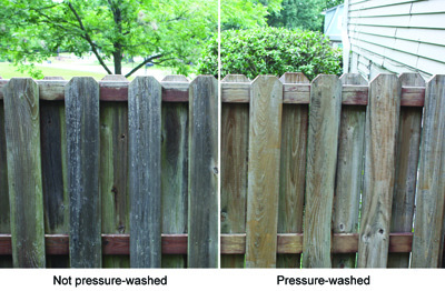 After the fence dries from the washing, it becomes evident how much dead wood and grime pressure-washing can remove.