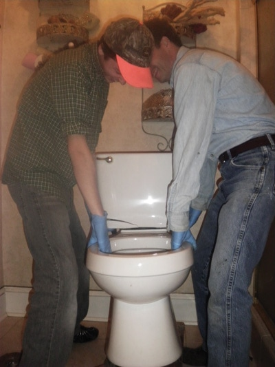 Lift the commode off the flange bolts to remove