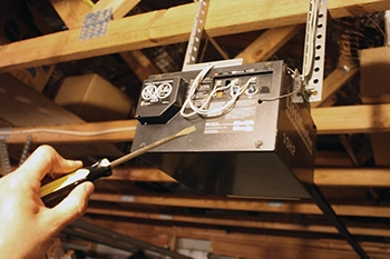 If the door doesn't close far enough or returns once it hits the floor, you probably need to adjust the travel setting of the door opener. Check with your manufacturer to determine the adjustment procedure. Some door openers have set screws you can adjust with a screwdriver, while other units have knobs or trip levers for adjustment.