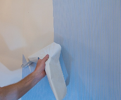 Some vinyl wallpapers can be removed by first peeling off the top vinyl layer.